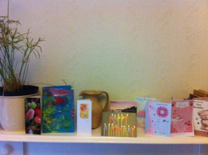 Birthday cards on the mantelpiece
