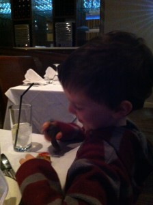 child eating shish kebab