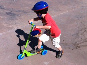 scooting at the skate park