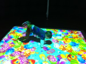 child playing with an interactive floor projection