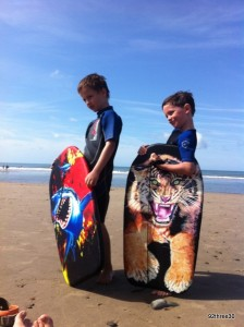 boys trying bodyboarding