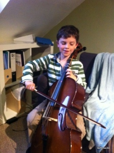 young cello player learning the cello