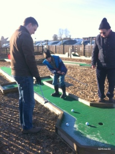 playing crazy golf with daddy and grandad