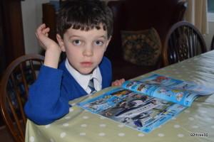 child reading catalogue