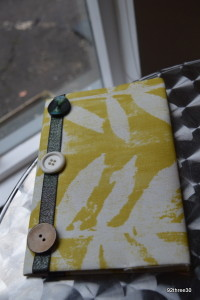 button and ribbon trim notebook