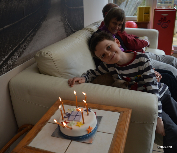 waiting to blow out candles on birthday cake