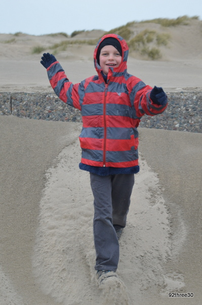 boy in the sand dunes