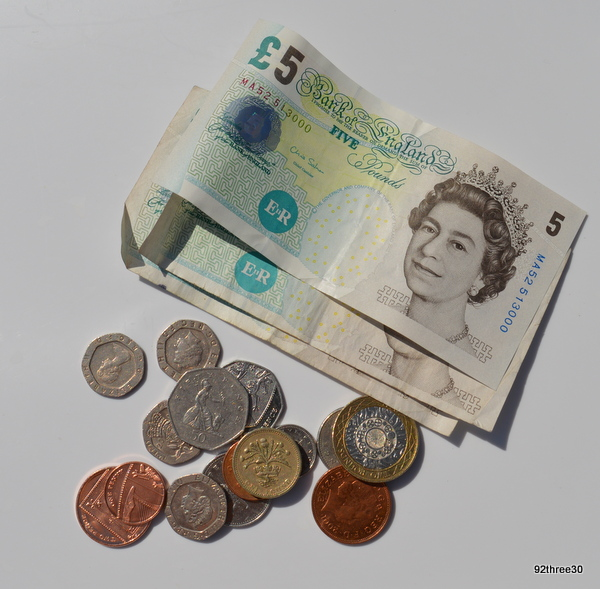 notes and coins pounds sterling