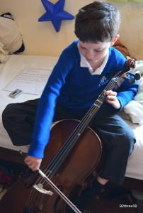 school boy celloist