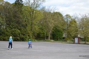 being taught to ride a bike