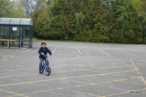 child getting cycling practice