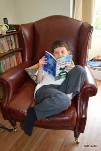 reading in a chair