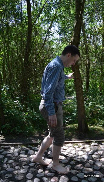walking barefoot on stones