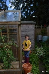 in the garden in mum's wellies