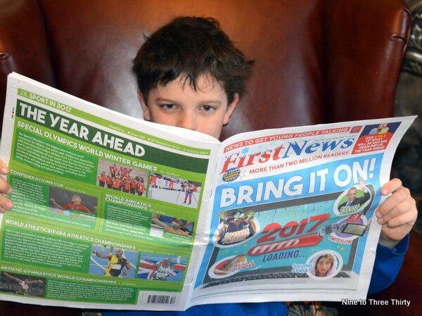 boy reading first news