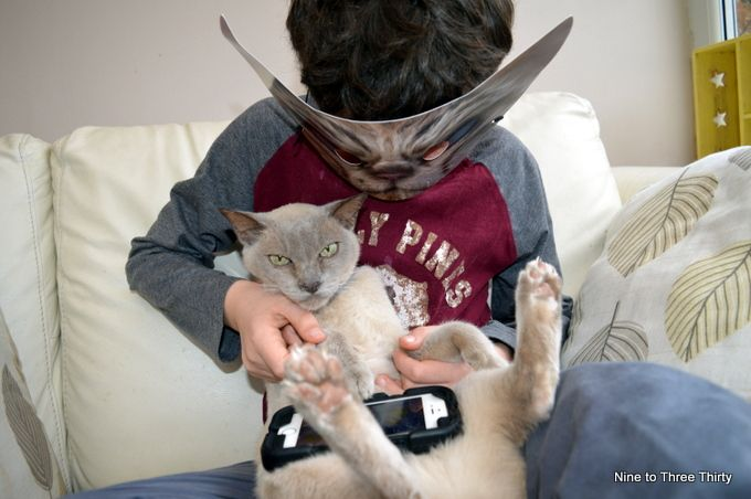 child in cat mask with cat