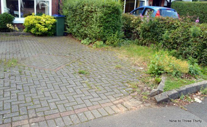 untidy weedy driveway
