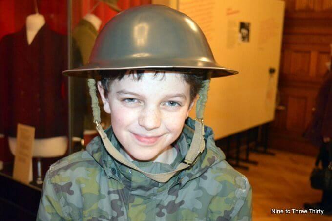 boy wearing army helmet