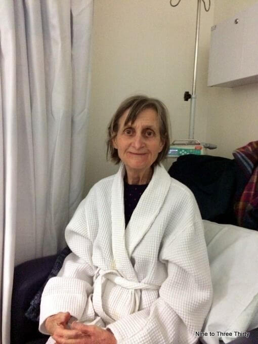 woman in dressing gown in hospital