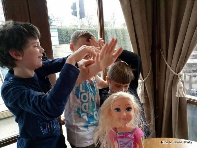 boys with doll