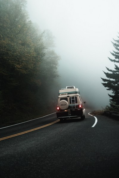 motor home on foggy road
