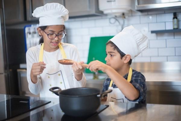 boy and girl chefs in kitchen
